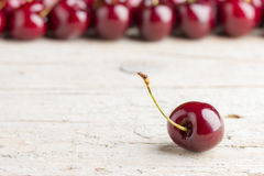 Cherries on wooden background Royalty Free Stock Photos