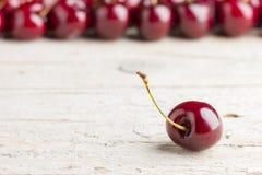 Cherries on wooden background. Fresh cherries on wooden background Royalty Free Stock Photos