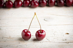 Cherries on wooden background. Fresh cherries on wooden background Stock Photo