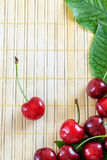 Cherries on wooden background Royalty Free Stock Image