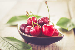 Cherries on wooden background Royalty Free Stock Photography