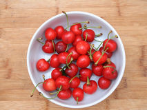 Cherries on wooden board Stock Images