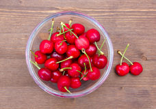 Cherries on a wooden bowl from above Stock Images