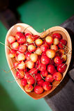 Cherries in wooden dish Royalty Free Stock Photos