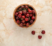 Cherries in wooden dish Stock Images