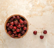 Cherries in wooden dish Royalty Free Stock Image