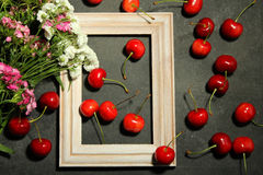 Cherries in wooden frame Stock Image