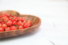 Cherries in a wooden plate Royalty Free Stock Images