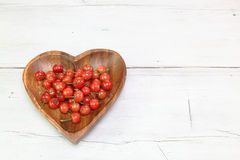 Cherries in a wooden plate Stock Photo