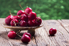 Cherries on wooden table Royalty Free Stock Image