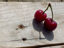Cherries. On a wooden table Stock Photos