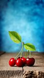 Cherries on wooden table Royalty Free Stock Photo