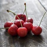 Cherries on wooden table Stock Photo