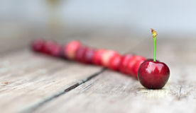 Cherries on a wooden table. Royalty Free Stock Photos