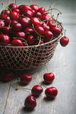Cherries on wooden table. Fresh cherries on wooden table Royalty Free Stock Images