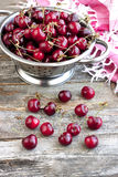 Cherries on wooden table Stock Photography