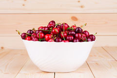 Cherries on wooden table Royalty Free Stock Photos