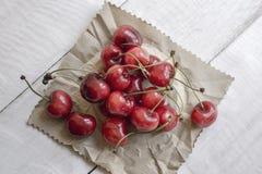 Cherries on wooden table Stock Photos