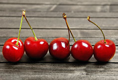 Cherries on wooden table Royalty Free Stock Images