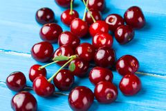 Cherries on wooden background Stock Photography