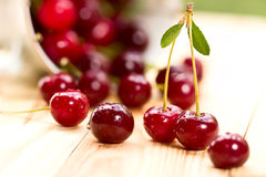 Cherries on wooden table with water drops macro background Royalty Free Stock Photos