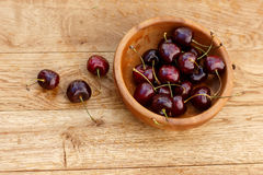 Cherries on wooden table with water drops Stock Photography