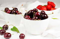 Cherris and Strawberries. Cherries and Strawberries in the white bowls Royalty Free Stock Photo