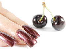 Cherry. Human hand on background red cherry Stock Image