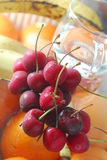 Cherry. With glass of water Stock Image