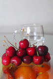 Cherry. With glass of water Royalty Free Stock Photography