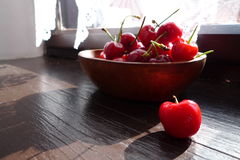 Cherry. A plate of fresh red cherry by the window Royalty Free Stock Photo