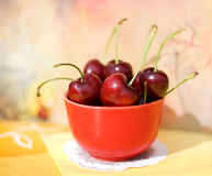 Cherry. Ripe fresh cherry in the red cup Stock Photography
