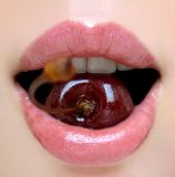 Cherry. Rose lips with cherry in teeth Royalty Free Stock Photos