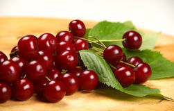 Cherry. Red cherry on a wooden board Royalty Free Stock Photography