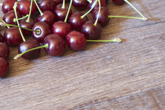 Cherry. On a wooden board stock photo