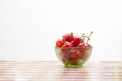 Cherry. A bowl of cherry fruit on the table Stock Photos