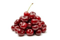Cherry. Red ripe cherry on a white background Stock Photos