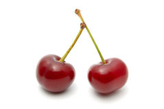 Cherry. Red ripe cherry on a white background Royalty Free Stock Photography