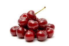 Cherry. Red ripe cherry on a white background Royalty Free Stock Images