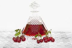 Cherry alcohol. On the white Stock Photos