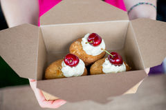 Cherry and Almond bakewell buns held in cardboard box Stock Photo