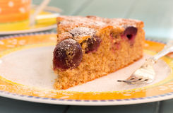 Cherry Almond Cake With Fork on Bright Plate Royalty Free Stock Photos