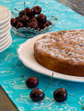 Cherry Almond Cake With Fresh Cherries. In bowl and blue striped table clooth Stock Images
