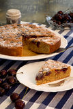 Cherry Almond Cake With Fresh Cherries. In bowl and blue striped table clooth Royalty Free Stock Photos