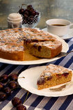 Cherry Almond Cake With Fresh Cherries And Coffee. Cherry Almond Cake with fresh cherries in bowl, coffee and blue striped table clooth Stock Image
