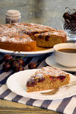 Cherry Almond Cake With Fresh Cherries And Coffee. Cherry Almond Cake with fresh cherries in bowl, coffee and blue striped table clooth Stock Photo