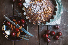 Cherry-almond pie on the table. Fresh and tasty pie with cherry and almondon the table. Dark colours Stock Photography