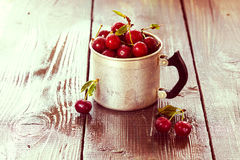 Cherry in a aluminum cup Stock Images