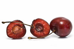 A cherry and another one cut. Royalty Free Stock Images