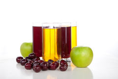 Cherry and apple juice. Cherries and apples on white Stock Photography